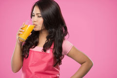 Pretty young wife drinking orange juice Stock Images