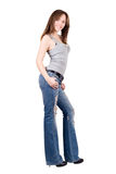 Pretty young woman. In a blue jeans. Isolated royalty free stock photography