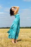 Pretty young woman. Posing in the field royalty free stock images