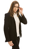 Pretty young woman. Stylish young woman in a blazer, wearing glasses royalty free stock image