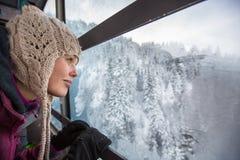 Pretty, young woman admiring splendid winter scenery Royalty Free Stock Image