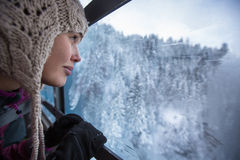 Pretty, young woman admiring splendid winter scenery Royalty Free Stock Photos