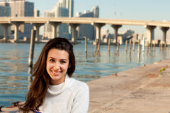 Pretty Young Woman along the Bay with Skyline Stock Photos