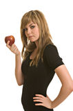 Pretty young woman with an apple. A pretty young woman tempting with a red apple Stock Photo