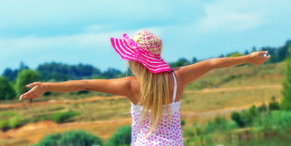Pretty young woman with arms raised Royalty Free Stock Images
