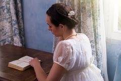 Regency woman reading book royalty free stock images