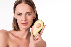 Pretty young woman with avocado Stock Photography
