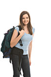Pretty young woman with backpack. Pretty young female student carries backpack royalty free stock photo