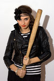 Pretty young woman with a bat Stock Photos