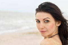 Pretty young woman on the beach Stock Photography