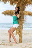 Pretty young woman on a beach Stock Images