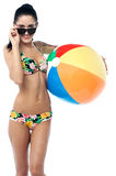 Pretty young woman with a beach ball Royalty Free Stock Photography