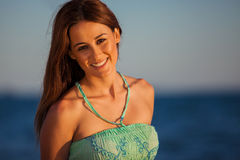 Pretty young woman at the beach Royalty Free Stock Images