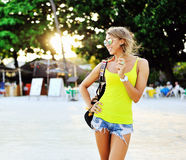 Pretty young woman on a beach in summertime Royalty Free Stock Image