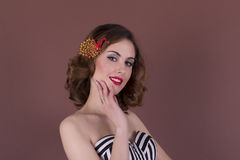 Pretty young woman with beautiful barrette on the hair. Studio shot Royalty Free Stock Photo