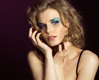 Pretty young woman with beauty make up close up Stock Photography