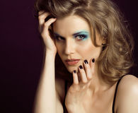 Pretty young woman with beauty make up close up Stock Image