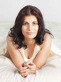 Pretty young woman in bed Stock Photo