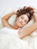 Pretty young woman in bed Stock Photos