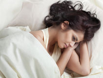 Pretty young woman in bed Royalty Free Stock Photography