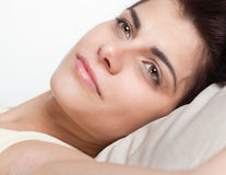 Pretty young woman in bed Royalty Free Stock Photo