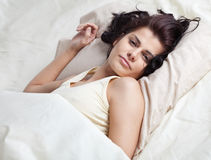 Pretty young woman in bed Royalty Free Stock Images