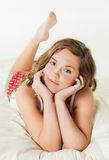 Pretty young woman in bed Royalty Free Stock Image