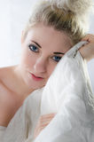 Pretty young woman with a bed blanket Royalty Free Stock Photography