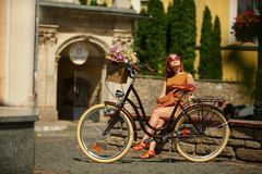 Pretty young woman with bicycle in the park Stock Photography