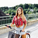 Pretty young woman on a bicycle in summertime Royalty Free Stock Image