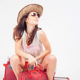 Pretty young woman with big luggage waiting your flight plane. Flight delay. Happy woman with luggage waiting plane, airline at airport terminal. Suitcase royalty free stock photo