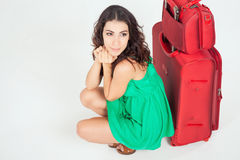 Pretty young woman with big luggage waiting your flight plane Stock Photos