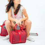 Pretty young woman with big luggage waiting your flight plane Stock Photo