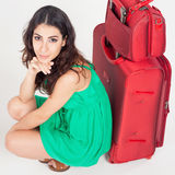 Pretty young woman with big luggage waiting your flight plane Royalty Free Stock Photography