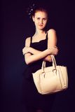 Pretty  young woman with big yellow bag standing posing Royalty Free Stock Images