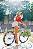 Pretty young woman on a bike Royalty Free Stock Photography