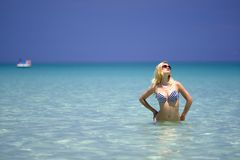 A pretty young woman in bikini relaxing in the sea Stock Images