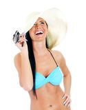 Pretty young woman in bikini and straw hat. Isolated on white Stock Image