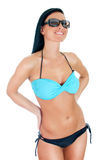 Pretty young woman in bikini and sunglasses hat. Stock Images