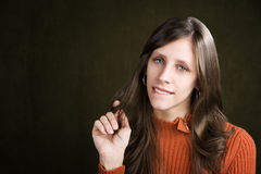 Pretty Young Woman Biting Her Lip Stock Photo