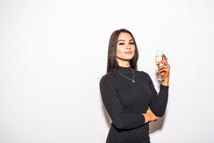 Pretty young woman in black dress drinking champagne Stock Photo