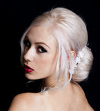 Pretty Young Woman with Blond Hair Up Royalty Free Stock Photos