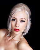 Pretty Young Woman with Blond Hair Up Royalty Free Stock Image