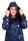 A pretty young woman in a blue raincoat Stock Photo
