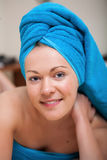 Pretty Young Woman with Blue Towel on Her Head Royalty Free Stock Image