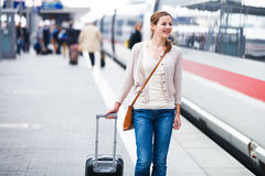 Pretty young woman boarding a train Royalty Free Stock Image