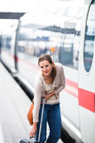 Pretty young woman boarding a train Royalty Free Stock Photography