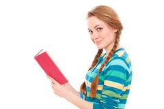 Pretty young woman with book Royalty Free Stock Photography