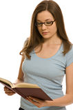 Pretty young woman with book stock photography