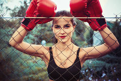 Pretty young woman in boxing gloves stock photos